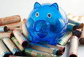 Blue Piggy Bank With Coin Wrappers Stock Photos