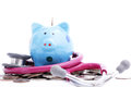 Blue piggy bank with stethoscope for check your finance Royalty Free Stock Images