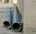 Blue pipes used in the construction of buildings to transport waste product to the sewage system Royalty Free Stock Photography