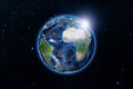 Blue planet earth from space showing America and Africa, USA, globe world with blue glow edge and sun light sunrise on space in a Royalty Free Stock Photo