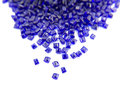 Blue plastic granules on black background Royalty Free Stock Image