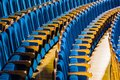 Blue plush chairs with wooden armrests in the auditorium. Empty auditorium in the theater Royalty Free Stock Photo
