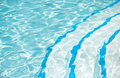 Blue pool with curved steps Royalty Free Stock Photo