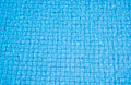 Blue pool water mosaic background in the sunny day Royalty Free Stock Photo