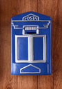 Blue Post box on wall Royalty Free Stock Photo