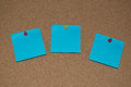 Blue Post it Notes on a Cork Board Royalty Free Stock Photo