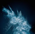 Blue powder exploding Royalty Free Stock Photo
