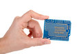 Blue prototyping pcb in a hand isolated on the white background Royalty Free Stock Photos