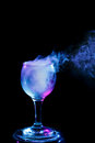 Blue and purple smoke in the glass. Halloween. Royalty Free Stock Photo