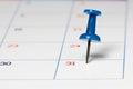 Blue Push Pin on Calendar Royalty Free Stock Photo