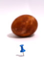 Blue pushpin and easter egg picture of Royalty Free Stock Photo