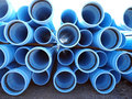 Blue pvc a stack of water pipe at a construction site Royalty Free Stock Photo