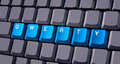 Blue qwerty button on keyboard close up Stock Photo