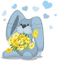 Blue rabbit  with daisy flowers Royalty Free Stock Photo
