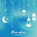 Blue Ramadan Kareem celebration greeting card. Hanging arabic lamp,