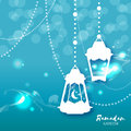 Blue Ramadan Kareem celebration greeting card. Hanging arabic lamps, stars and crescent moon. Royalty Free Stock Photo