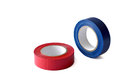 Blue and red insulating tape rolls isolated on white background Stock Photography