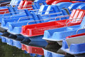 Blue and red plastic vessels waiting for tourists to have some fun Royalty Free Stock Photography