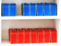 Blue and red toy cases on the shelf background Royalty Free Stock Photo