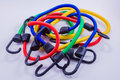 Blue, Red, Yellow, and Green Bungee Cords Royalty Free Stock Images