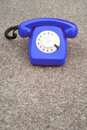 Blue retro phone old on grey background copy space Royalty Free Stock Image