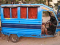 Blue rickshaw still standing on the street Royalty Free Stock Photography
