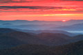 Blue ridge parkway autumn sunrise an as seen from pounding mill overlook off the in western north carolina Stock Photos