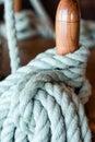 Blue rope on belaying pin sailing ship Royalty Free Stock Photo