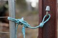 Blue rope make shift latch to secure a rural gate using nylon Stock Photos