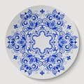 Blue round floral ornament pattern applied to the ceramic plate vector illustration Stock Images