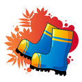 Blue rubber boots on autumnal background Royalty Free Stock Photos