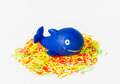 Blue rubber whale on the colorful elastic Stock Images