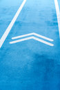 Blue Running track with double arrows symbol Royalty Free Stock Photo