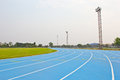 Blue running track in sport stadium Royalty Free Stock Photography