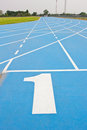 Blue running track in sport stadium Royalty Free Stock Image