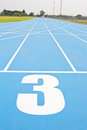 Blue running track in sport stadium Stock Image