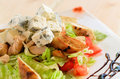Blue salad with chicken meat, blue cheese, iceberg, lettuce, tomato, bread and dressing Royalty Free Stock Photo