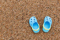 Blue sandals slipper on the sand pair of slippers crocs Royalty Free Stock Photography