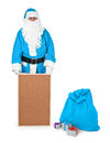 Blue santa claus shows empty bulletin board on white minimal natural shadow in front Stock Photography