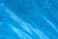 Blue satin drapery coloured textile surface Royalty Free Stock Photography