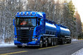 Blue Scania R580 Double Tanker Trucking on Winter Afternoon Royalty Free Stock Photo