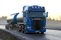 stock image of  Blue Scania R580 Tank Truck Transport at Sunset