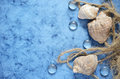 Blue sea background with shells and a rope Stock Photo