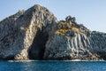 Blue sea and characteristic caves of Cala Luna Golfo di Orosei Sardegna or Sardinia Italy Royalty Free Stock Photo