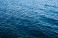 Blue sea peacful background with ripples in water Royalty Free Stock Photo