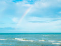 Blue Sea and Sky in Thailand with Rainbow after Raining