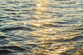 Blue sea water surface at sunset with sparks Royalty Free Stock Photo