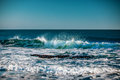 Blue sea with waves and clear blue sky Royalty Free Stock Photo