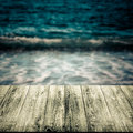 Blue sea waves over old light wooden table or board. Collage. Se Royalty Free Stock Photo