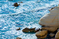 Blue sea yellow rock backgroung with a Royalty Free Stock Photography